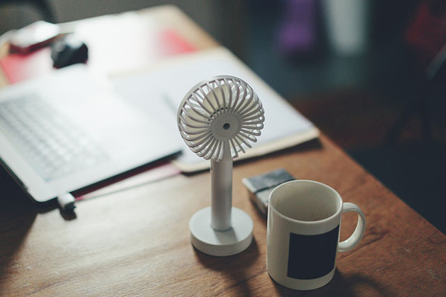 Smart plugs are great for powering office devices such as fans, like the miniature fan in this picture.